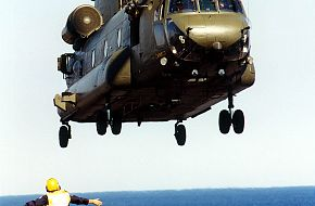 RAF Chinook being marshalled on the deck of HMS Ocean.