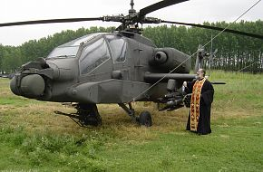 A greek orthodox priest bless an AH-64A+ Apache Hellenic Army