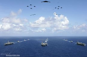 Carrier Strike Groups sail in formation - Valiant Shield 2006.