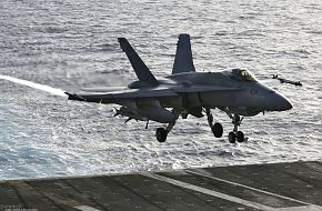 F-18 Fighter on USS Kitty Hawk (CV 63) Aircraft Carrier