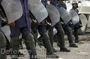 Riot police stand guard - News Pictures