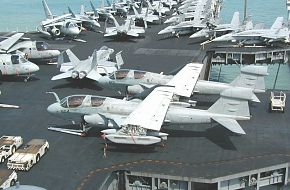 Prowlers and F/A-18C's on USS Kitty Hawk in Singapore 2002