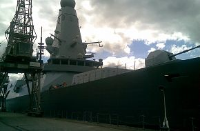 HMS Daring alongside...