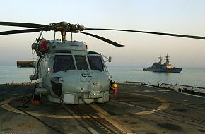 USS Mobile Bay CG-53 and SH-60 Helicopter