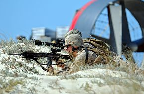 Marines take tactical positions, Amphibious beach assault