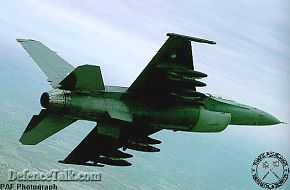 Pakistan F-16 carrying 4 TER's with 3 MK.82 GP bombs each banking left. (PA