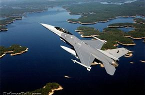 A beautiful shot of a Thai A/F F-16 over a river.