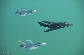 Two F-16s with a Nighthawk F-117