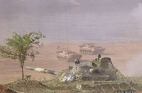 Tank in cover BMP-2s by river