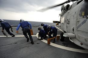 SH-60K helicopter, Sailors remove chocks and chains