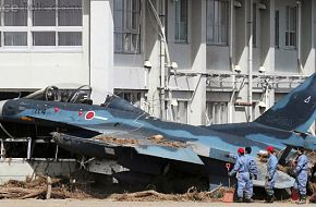 F-2 Aircraft hits building during Japan Tsunami