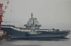 Chinese Aircraft Carrier from the port bow.