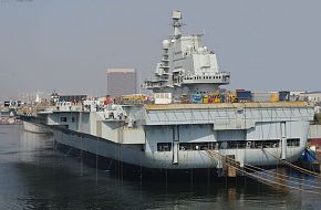 Full view of the new Chinese PLAN aircraft carrier from the port quarter