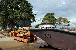 Bulldozer unloading from Fast Craft at Meulaboh