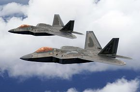 Two F-22 Raptors fly over Joint Base Pearl Harbor-Hickam, Hawaii