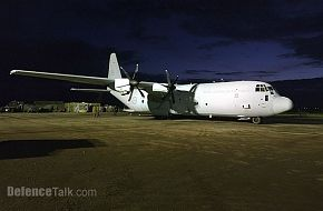 A RAAF C-130J parked on the ramp in Aceh moving internally displaced person