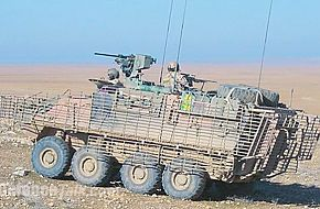 "An Australian ASLAV in Iraq fitted with new ""bar armour"" to stop"