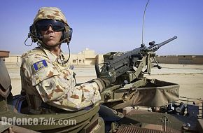 a @nd Cavalry Regt troop Sgt patrolling in his ASLAV as part of Al Muthanna