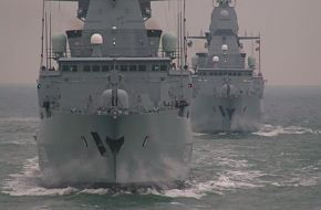 Two german Type 124 frigates in formation.