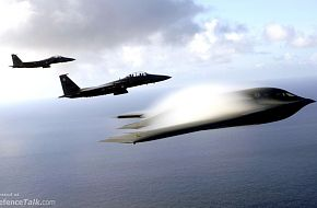 A B-2 Spirit and F-15E Strike Eagles