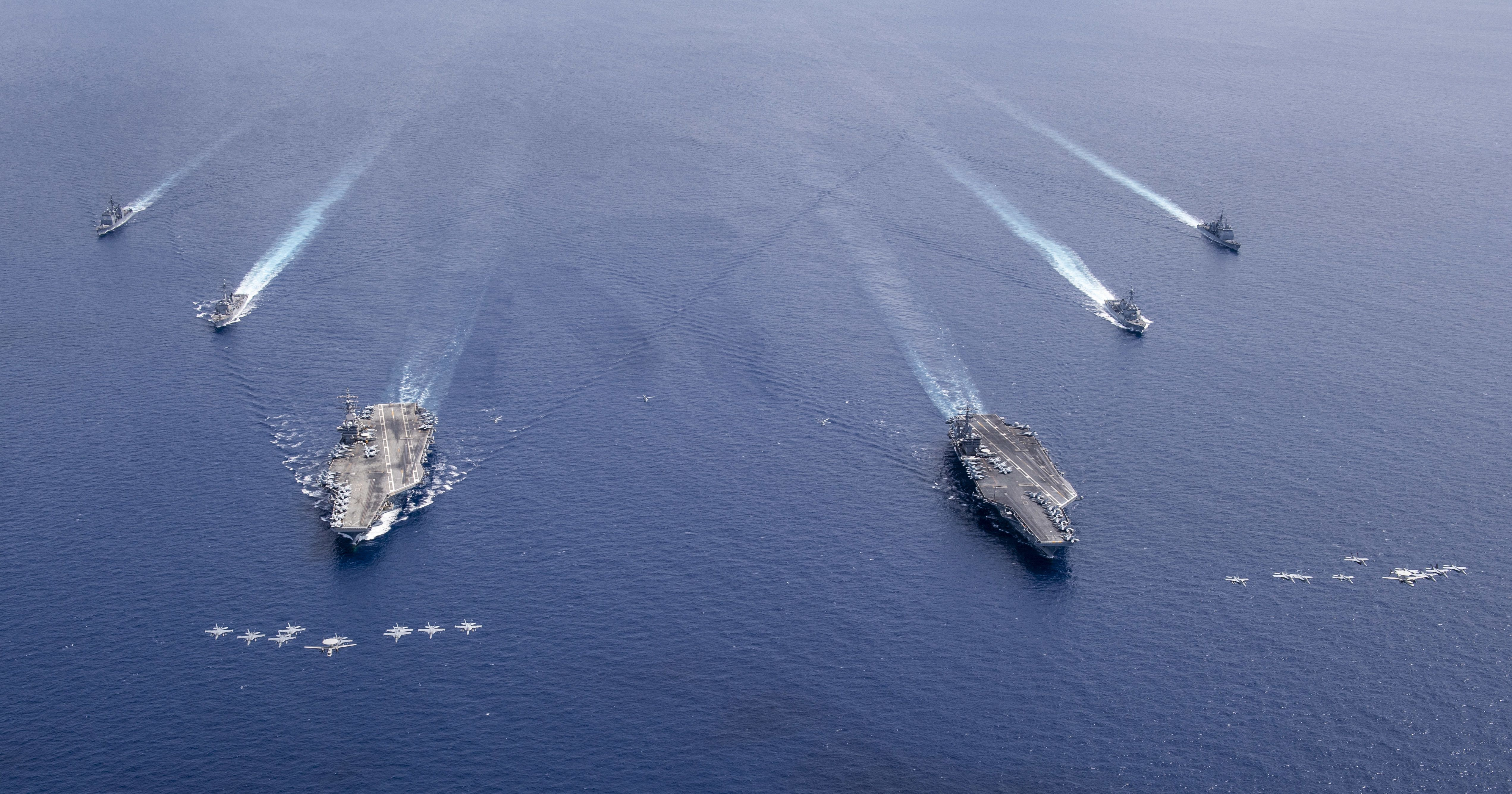 Aircraft from CVW 5 and 17 fly in formation over the Nimitz Carrier Strike Force