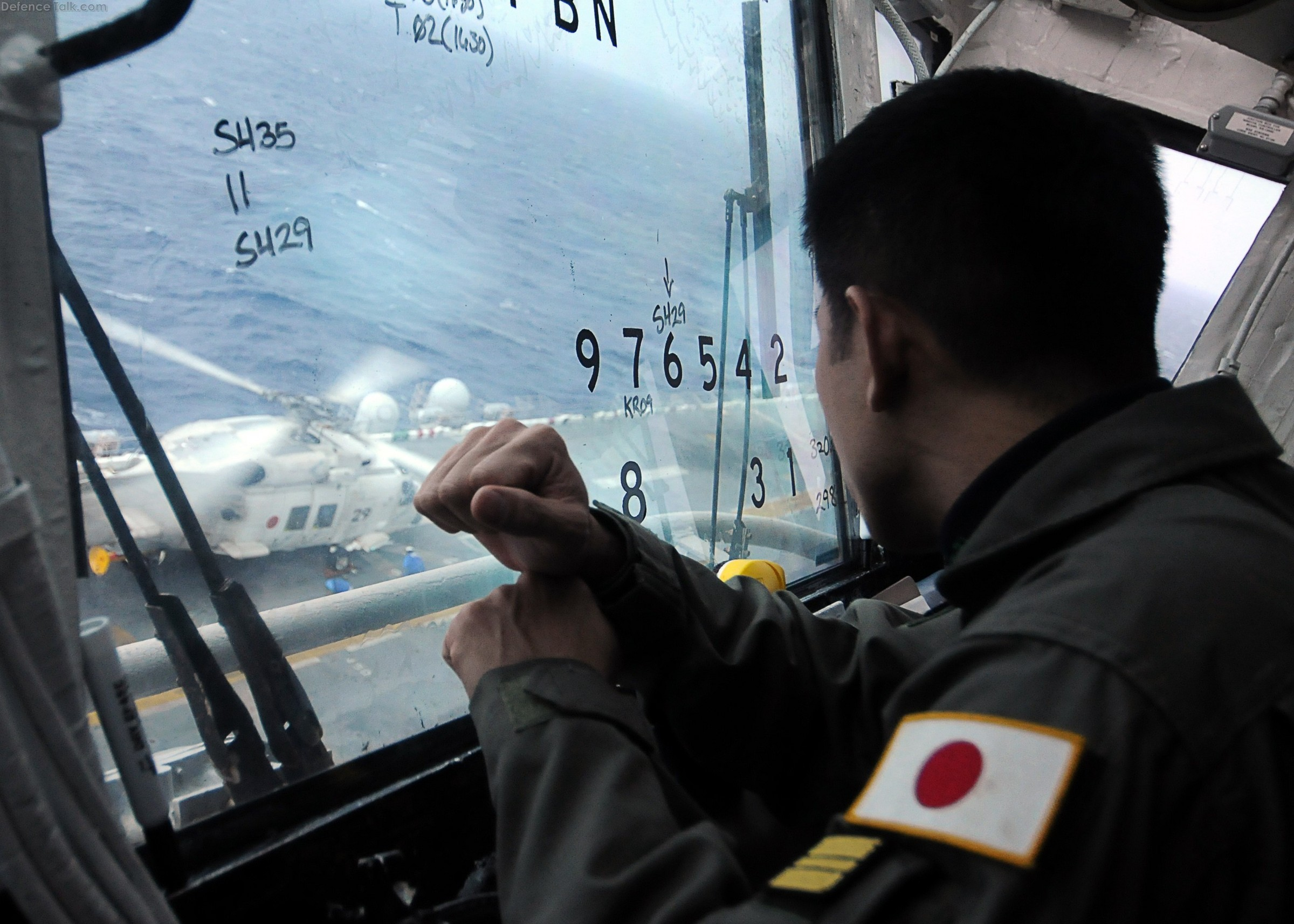 JMSDF SH-60K Sea Hawk helicopter lands