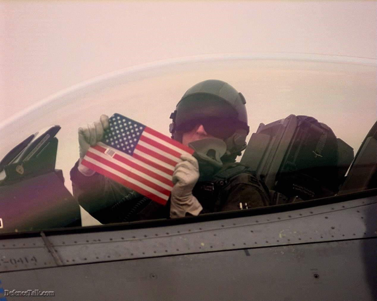 USAF pilot with US flag.