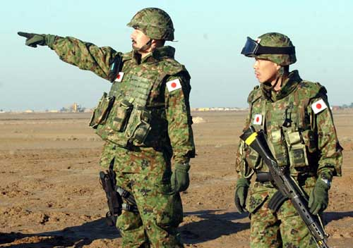 Japan plans to raise military budget amid China row
