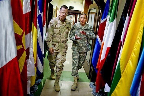 As he hangs up uniform, Petraeus warns...
