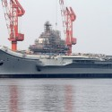 China's aircraft carrier puts naval ambitions on show