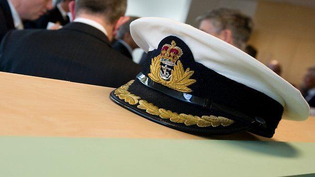 Australian navy officer in spanking sc...