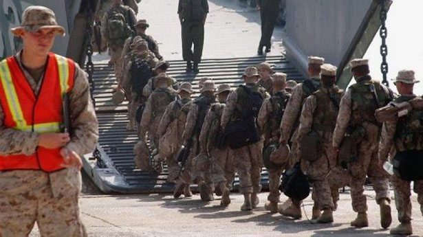 US Marines may leave Japan before base...