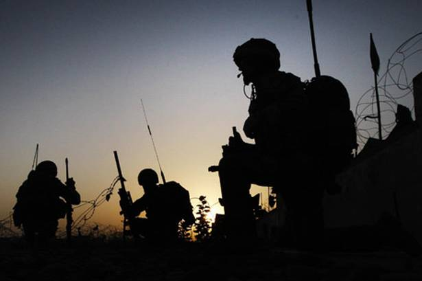 NATO Mulls Funding Afghan Troops Throu...