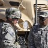 Brig. Gen. Michael Williamson, joint program executive officer, JTRS, discusses radio performance with a Soldier at the Network Integration Evaluation 12.1 at White Sands Missile Range, N.M.