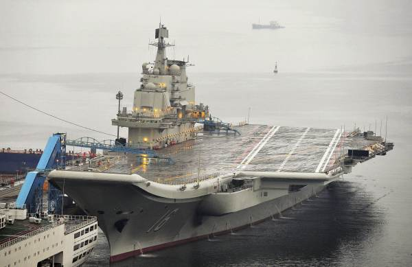 China's First Aircraft Carrier Commiss...