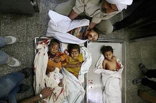 Gazans bury family as Israeli bombs fall