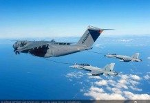 A400M‬ refuels two F-18 fighters simultaneously