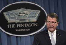 Ashton Carter briefs the press at the Pentagon