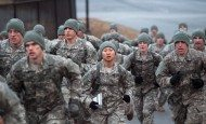 Potential male and female Ranger course students run in formation during the Ranger Training Assessment Course at Fort Benning, Ga., Jan. 24, 2015.