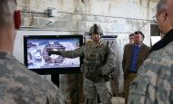 1st Lt. Cole W. Holland, Headquarters and Headquarters Battery, 2nd Battalion, 17th Field Artillery Brigade, 2nd Regiment, 2nd Stryker Brigade Combat Team, 2nd Infantry Division, Fort Lewis, Wash., demonstrates the Maneuver Aviation Fires Integrated Application at the Army Expeditionary Warfighter Experiments on Fort Benning, Ga., March 3, 2015.