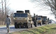 A column of military vehicles carrying a Patriot missile system, from Delta Battery, 5th Battalion, 7th Air Defense Artillery Regiment, arrives for a training exercise at Sochaczew, Poland, March 18, 2015.