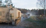 Track and wheel vehicles, from 3rd Battalion, 69th Armor Regiment, 1st Armor Brigade Combat Team, 3rd Infantry Division, convoy from their motorpool at the Grafenwoehr Training Area, Germany, to the railhead, April 20, 2015.