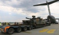 An M1A2 Abrams tank unloads from a C-17, Burgas, Bulgaria, June 20, 2015. Transported as part of a tank section from Germany to Bulgaria, the Abrams tank will be used by Soldiers, from 3rd Battalion, 69th Armor Regiment, and 2nd Squadron, 2nd Cavalry Regiment, alongside Bulgarian soldiers, from the 6th Brigade Battle Group, during a tank live-fire exercise during Operation Speed and Power.