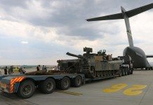 M1A2 Abrams tank unloads from a C-17