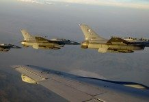 F-16s from the Pakistan Air Force fly near a KC-135 after refueling