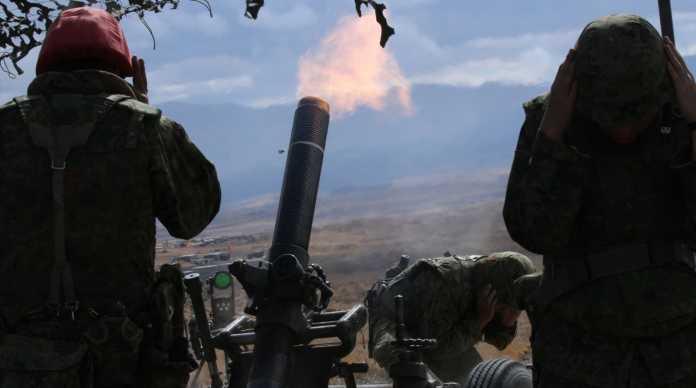 firing a 120-millimeter mortar