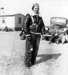 "Bernice ""Bee"" Haydu, a Women's Airforce Service Pilot, or WASP, during World War II, prepares to fly a Stearman Kaydet during flight training at an auxiliary field near Avenger Field in Sweetwater, Texas, in 1944. Because the plane was an open cockpit bi-plane, during the winter months, the pilots wore winter gear such as a fleece-lines helmet and pants. They would make flight notes on the adhesive tape on the pants. (Courtesy photo)"